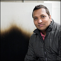 Ph.D. candidate Ajay V. Singh with the results of a vertical wall test that shows the effects of a burning fuel's temperature gradient.