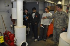 Lt. Colonel Hubner instructing STS students (Katie Schlee, Pulkit Malik, and Peter Barber) on the Symons Hall HVAC Pump System (Credit: Isadore Beattie, October 2014)