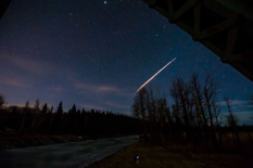 This Monday, Feb. 23, 2015, ten second time exposure photo provided by Neil Zeller, shows a streak of light from what is believed to be a Chinese rocket burning up upon re-entry, in the atmosphere as seen from Calgary, Canada.