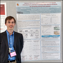 Department of Materials Science and Engineering (MSE) graduate student Travis Dietz with a poster on his research.