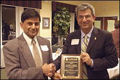 Professor Ashwani K. Gupta receives the A. James Clark School of Engineering Outstanding Research Award from Clark School Dean Nariman Farvardin.