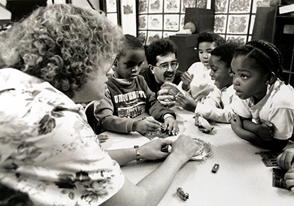 Dr. Denice Denton (L) and her graduate student Reza Ghodssi (C) share engineering concepts with children at the University of Wisconsin in the early 1990s.