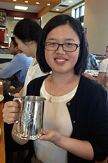 Zhiwei Huang with her 'Best Student Presentation Award' prize cup.